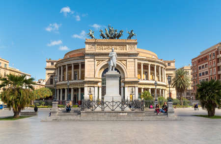 Palermo, Sicily, Italy - October 5, 2017: People resting in front of the famous Politeama Garibaldi theater in Palermo.