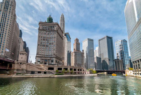 View of Chicago skyscrapers with Mather Tower and London Building from Chicago River, Illinois, USA Editorial