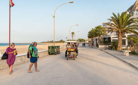 San Vito Lo Capo, Trapani, Italy - October 3, 2016: People walking on the promenade in San Vito Lo Capo.
