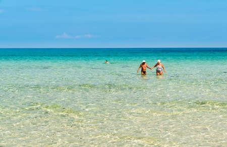 San Vito Lo Capo, Trapani, Italy - September 16, 2016: Happy couple enjoying a romantic walk in San Vito Lo Capo beach. Stock Photo