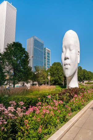 Chicago, Illinois, USA - August 15, 2014: The Awilda biggest Head sculpture of Spanish sculptor Jaume Plensa at the Millennium Park in Chicago.