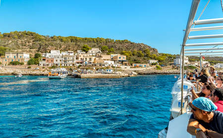 Levanzo, Sicily, Italy - September 22, 2016: Tourists arriving by ferry on the Levanzo island, is the smallest of the three Aegadian islands in the Mediterranean sea of ??Sicily.