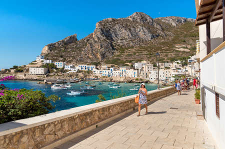 Levanzo, Sicily, Italy - September 22, 2016: Visitors enjoy the coastline during their trip to the village of Levanzo, the smallest of the Egadi.