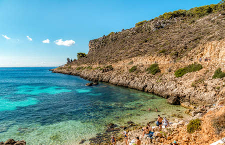 Levanzo, Trapani, Italy - September 22, 2016: Visitors enjoying the Cala Fredda beach during their trip on the Levanzo island in the Mediterranean sea of ??Sicily.