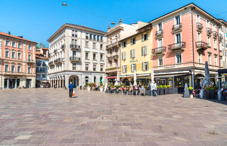 Lugano, Ticino, Switzerland - April 20, 2018: View of Piazza della Riforma with many bars, restaurants and bistros, is the main square in the historic center of Lugano. Sajtókép