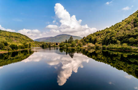 Landscape of the lake with reflection of the clouds, Valganna in Province of Varese, Italy