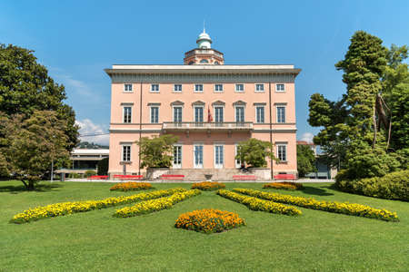 Lugano, Ticino, Switzerland - July 27, 2018: View of Villa Ciani with colorful flowers foreground in the public city park of Lugano, Switzerland Editorial