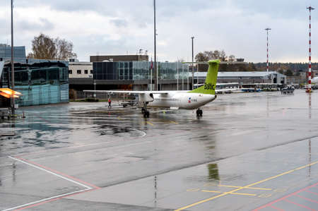 Riga, Latvia - October 28, 2018: AirBaltic Aircraft preparation for departure in the Riga International Airport.