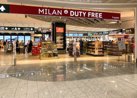Ferno, Milan-Malpensa, Italy - April 3, 2019: Milan Duty Free shopping area inside the Terminal 1 of Milan Malpensa International Airport.