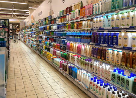 Varese, Italy - Marc 7, 2019: Lanes of shelves with Hygienic products various brands and manufacturers inside the IPER of Varese hypermarket.
