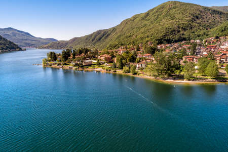 Aerial view of small village Brusimpiano located on the shore of lake Lugano in province of Varese, Lombardy, Italy Reklamní fotografie