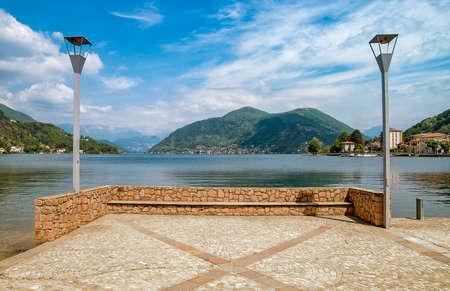 Landscape of lake Lugano on a cloudy day, Porto Ceresio Tresa, Italy Reklamní fotografie
