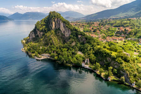 Aerial view of Rocca of Calde and Lake Maggiore in background, in the summer day, Castelveccana, Italy