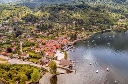 Aerial view of the village and the small harbor of Castelveccana, located on the shore of Lake Maggiore in the province of Varese, Lombardy, Italy