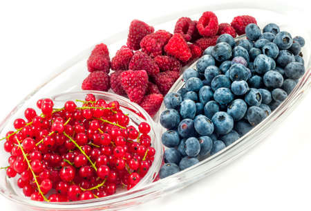 Mix of fresh berries. Raspberry, red currant and blueberries. Reklamní fotografie