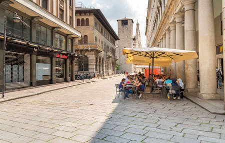 Como, Lombardy, Italy - June 18, 2019: People enjoying a street bars and restaurants in the historic center of Como in a hot summer day, Italy