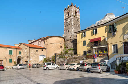 Colonnata, Tuscany, Italy - July 6, 2019: Central square with bell tower in ancient village Colonnata, located in the province of Massa-Carrara in Tuscany, Italy