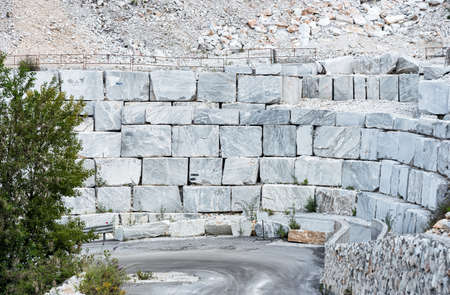 Blocks of white marble in the marble quarry of Carrara in the Apuan Alps in Tuscany, Italy