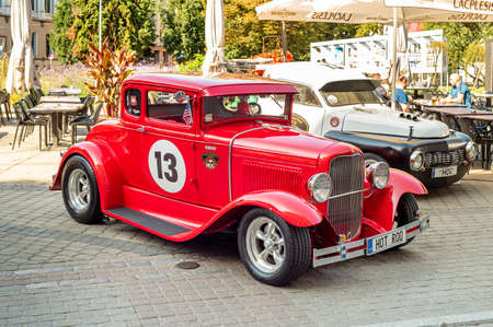 Riga, Latvia - September 5, 2019: View of the Red Hot Rod vintage car parked in the Old Riga, Latvia