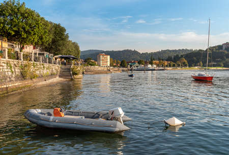 Promenade on the shore of Lake Maggiore in Laveno Mombello, province of Varese, Italy