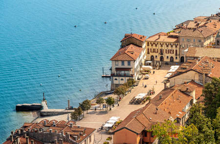 Top view of Arona city situated on shore of lake Maggiore in province of Novara, Piedmont, Italy