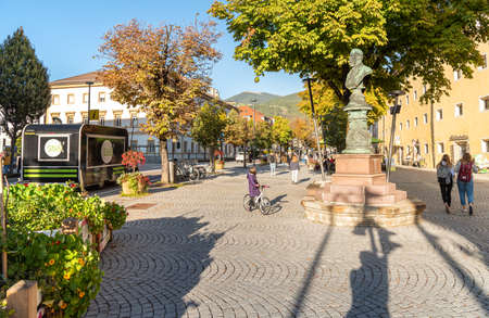 Bruneck - Brunico, South Tyrol, Italy - October 19, 2019: The main street with bars and shops in the historic center of Bruneck, Italy