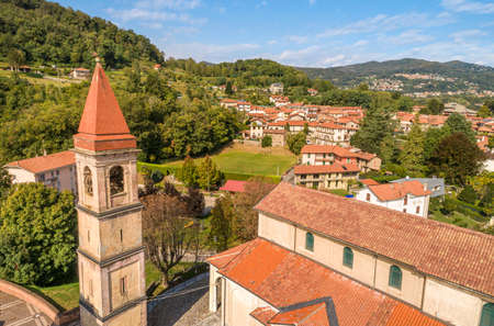 Aerial view of Dagnente with the San Giovanni Battista church, above Arona city, Piedmont, Italy Stock Photo
