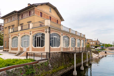 Luino, Lombardy, Italy - May 8, 2020: View of Verbania Palace on the coast of Lake Maggiore, a place of culture and symbol of Liberty in Luino, Lombardy, Italy