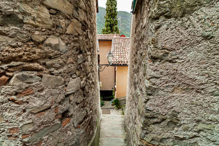 Narrow street of the ancient village Albogasio - Oria, is part of the municipality of Valsolda, in the province of Como, in the Lombardy region, Italy 版權商用圖片