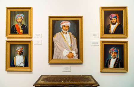 Muscat, Oman - February 10, 2020: Portraits of Sultan Qaboos and his royal family inside the Bait Al Zubair Museum in old Muscat or Sultanate of Oman 新聞圖片