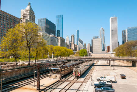 Chicago, Illinois, USA - April 23, 2012: View of Chicago Downtown Skyline with railroad yard under bridge, USA