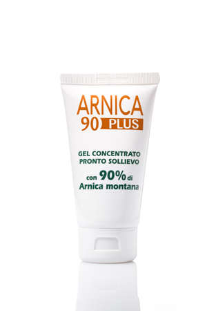 White plastic tube with Arnica 90 Plus gel isolated on white background. 新聞圖片