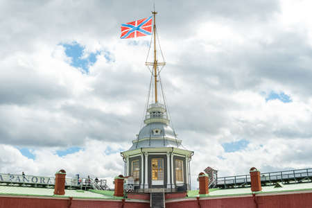 Saint Petersburg, Russia - June 17, 2015: Flag on the roof of the Naryshkin bastion of Peter and Paul Fortress in Saint Petersburg, Russia