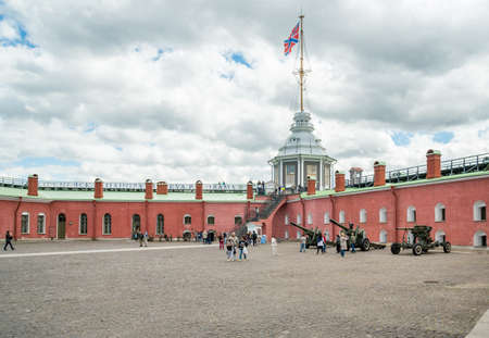 Saint Petersburg, Russia - June 17, 2015: Naryshkin Bastion and Flag Tower of Peter and Paul Fortress on Neva River.