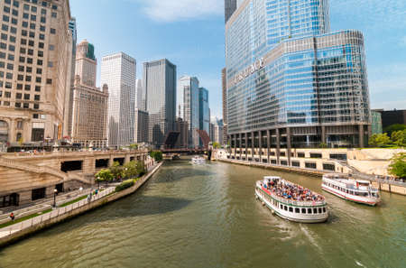 Chicago, Illinois, USA - August 24, 2014: View of Chicago River with skyscrapers and tourist boats, USA