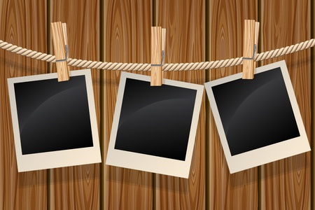 pegs: Photos hanging on a clothesline