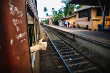good bye: Hands showing good bye through train window