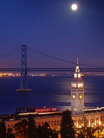 The moon above Ferry Building & Bay Bridge. Stock Photo - 6451846
