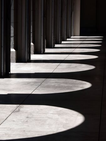 This is a picture of light & shadow between arch. photo