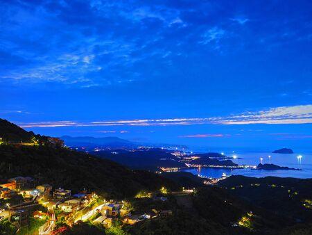 Beautiful night scene of coastline in Taipei Stock Photo
