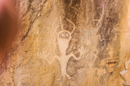 Rock carving of people Stock Photo