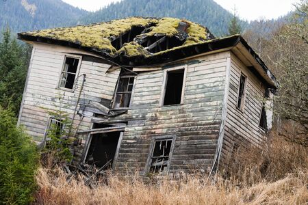 Slanted, rotting wooden house, haunted house