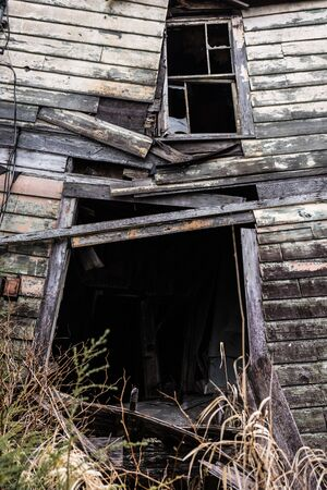 Front entry way of old haunted house, crumbling wooden planks Stock fotó