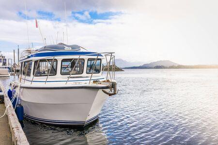 Single fishing boat docked facing open ocean, Ketchikan Alaska