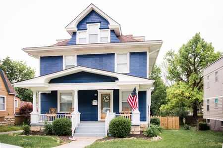 Beautiful navy blue colonial with large front porch in historic Dougherty neighborhood, Independence Missouri