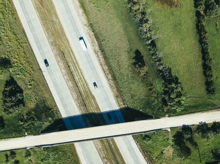 Aerial drone shot of dual direction american highway or freeway