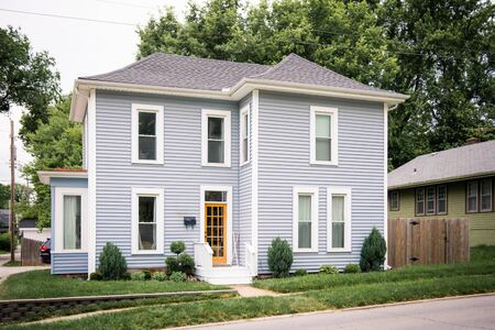Quaint single family home, modern colors, tall colonial windows, curb side Stok Fotoğraf