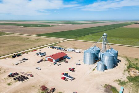 Drone shot of american farmland, machinery storage and grain silos Stock Photo