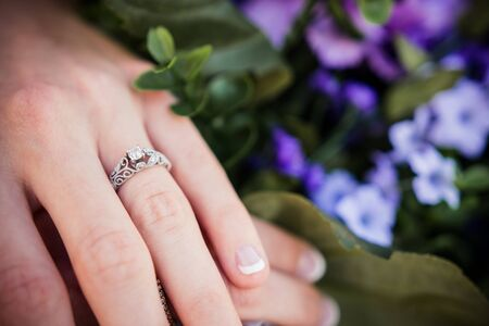 Bride shows off diamond studded wedding ring before ceremony
