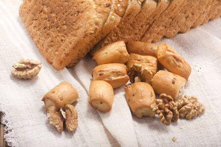 pone: bread, hardtack and walnut on background with soft shadow
